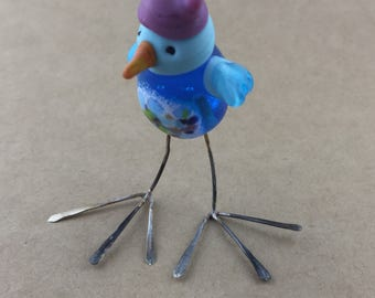 Little bird in a pink hat - resistant twitter feed