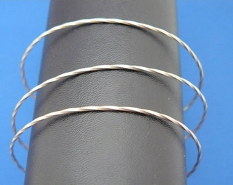 Twisted sterling silver wire slave bracelet