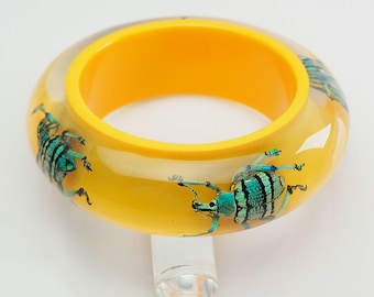 Funky bright yellow bangle bracelet with real exotic beetles