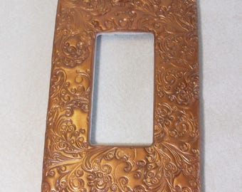 Screwless rocker style single light switch cover curly swirly bronze