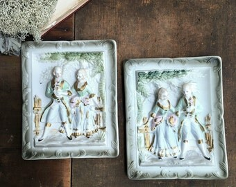 Victorian Chase Plaques - Pair of Colonial Bisque Porcelain Wall Hangings