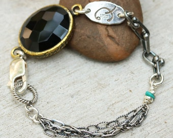 Oval faceted onyx bracelet in brass bezel setting with turquoise beads secondary gemstone and oxidized sterling silver triple chain