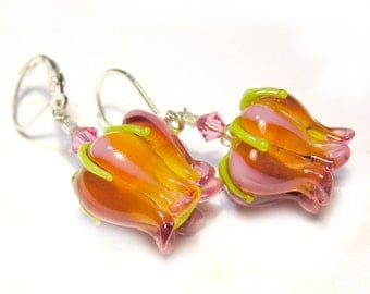 A pair of handmade lampwork earrings with tulip flowers sterling silver
