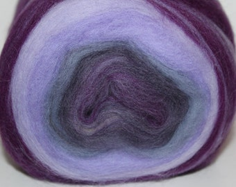 Merino wool center pull self striping roving bump.  Super soft and a treat to spin. Weighs 4-5oz