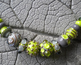 Lime Green Gray Lampwork Beads by Cherie Sra R114 Flameworked Glass Bead Lime Green Gray Lampwork Bead Double Helix  Silver Glass Lampwork