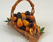 12th scale handwoven miniature basket of papaya and passion fruit.