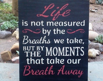 Life is not measured by the Breaths we take.....Wooden Sign