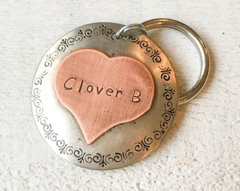 Our dog tags make a unique personalized gift. Each pet id tag is crafted in our Bozeman, Montana studio by dog lovers. Clover Pet Tag