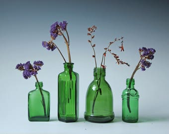 A Collection of 4 antique vintage emerald green bottles - flower vase