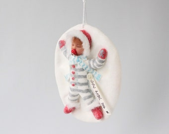 Sleeping Baby Snow Angel Ornament. Baby's first Christmas snow glitter snow angel pacifier red mittens striped suit