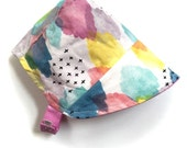 UB2 ORGANIC DAYDREAM a rainbow sky reverses to bright pink crosses on this adorable baby summer sun hat, by Urban Baby Bonnets (all sizes)