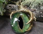 Gothic Steampunk Single Claw Pendant with Golden Green Eye