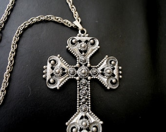 Boho vintage 70s pewter necklace with a large ornate cross pendant. Made by Sarah Coventry.