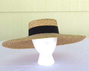 Vintage very wide brim straw hat with black grosgrain band and bow