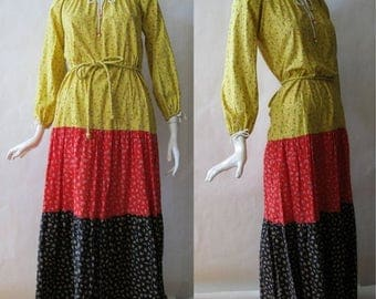 MOVING 4 GRADSCHOOL SALE 1970's festival dress, long, in color block stripe panels of yellow, red, and black floral prints, about a medium