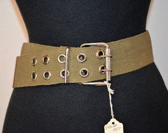 90s military wide woven belt.  Green with silver tone grommets.  Wide double prong.  NOS 28 through 33 waist low hip safari webbing canvas