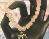 Rose Quartz Beaded Stretch Bracelet With Emerald Green Angel Charm