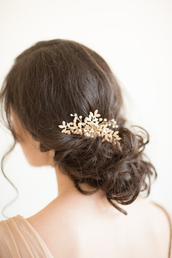 Gold Bridal Comb, Wedding Hair Comb, Gold Wedding Headpiece, Pearl Wedding Comb, Gold Leaf Bridal Comb Gold Bridal Comb, Wedding Hair Comb, Gold Wedding Headpiece, Pearl Wedding Comb, Gold Leaf Bridal Comb Gold Bridal Comb, Wedding Hair Comb, Gold Wedding Headpiece, Pearl Wedding Comb, Gold Leaf Bridal Comb Gold Bridal Comb, Wedding Hair Comb, Gold Wedding Headpiece, Pearl Wedding Comb, Gold Leaf Bridal Comb Gold Bridal Comb, Wedding Hair Comb, Gold Wedding Headpiece, Pearl Wedding Comb, Gold Leaf Bridal Comb zoom Item details 5 out of 5 stars. (3,434) reviews Shipping & Policies Gold Bridal Comb This wedding hair comb is embellished with hand wired pretty leaves that sparkle with tiny rhinestones, freshwater pearls and crystals. The brass flower is hand painted with a pearl enamel but can be kept as a bright gold brass color by request. Please note that these are handmade items and can vary slightly in appearance from piece to piece. ♥ SIZE: Approximately 4 1/2