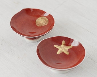 Hand build porcelain  two bowl set in red with gold sea creatures