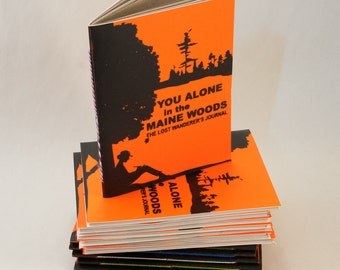Fluorescent Orange Vinyl Notebook Titled You Alone in the Maine Woods, based on The Lost Hunter's Guide