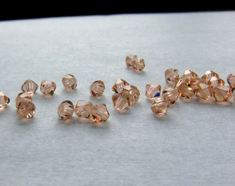 4mm Light Peach Swarovski Bicone Beads - (40)