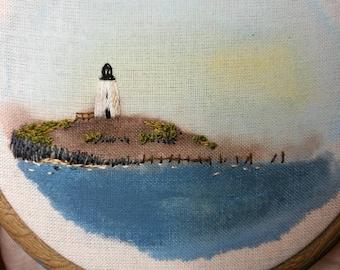 Lighthouse Embroidery on Acrylic Background