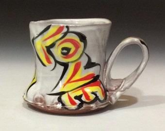 Love mug with red yellow black on white