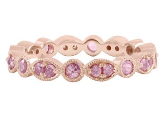 Women's rose gold eternity stackable wedding band with pink sapphires