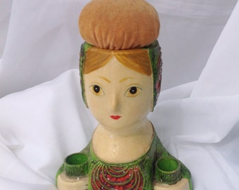 Vintage green and red lady lipstick holder and pincushion. Vintage vanity hair stylist salon.
