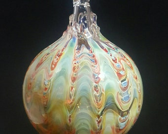 Blown glass ornament...molten colors by Erin Cartee