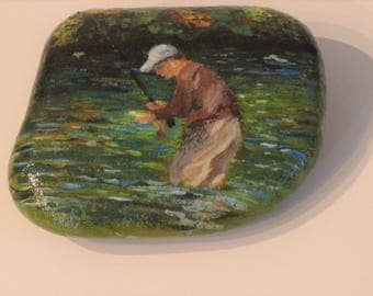 Painted rock, fisherman holding fish, trout fishing art, trout stream, fly fishing art, office decoration, home decor, cabin art