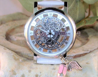 Silver on Silver See-Thru Looks Like Mechanical Skeletal Wrist Watch with White Leather-like Band Tiny Pink Pencil Charm A 372