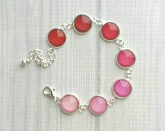 Pink Bracelet - silver plated glass charm shades of pink to red adjustable chain - round bezel set ombre shaded rainbow light to dark simple