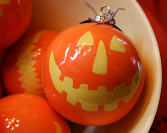 Ceramic Christmas Ornament Jack-o'-Lantern Face Ball Ornament in Orange and Yellow