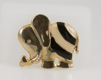 Vintage Gold Elephant Brooch Pin with black and pearlized enamel. Love the circus love this very cute lapel pin, Nice size stands out