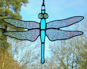 Stained Glass Ornament (Dragonfly) iridescent wings, sky blue body and pale green eyes.