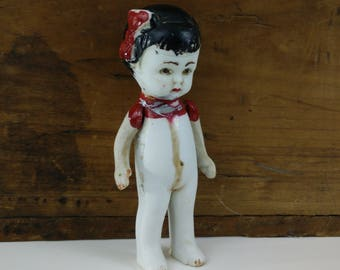 Antique Bisque Doll with jointed arms, made in Japan