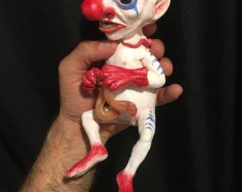 clown fetus sculpture