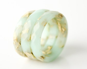 size 8.5 thin multifaceted eco resin ring | mint green eco resin featuring gold metallic flakes