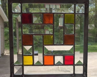 Beveled and Red, Orange, Yellow Colored Glass Stained Glass Panel