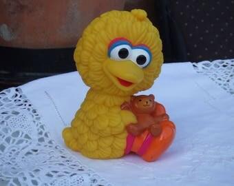1995 Baby Big Bird Plastic Toy. 5 and a Half Inches Toy. Baby Big Bird Holding His Teddy Bear. Very Well Made.