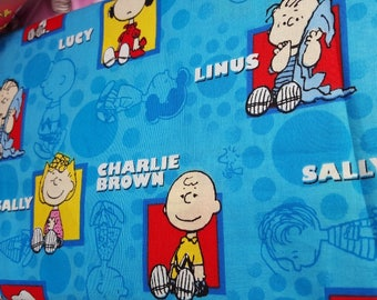1.25 yd piece Peanuts Characters on Blue cotton fabric from Springs Creative - snoopy, charlie brown, lucy, linus, sally- last piece