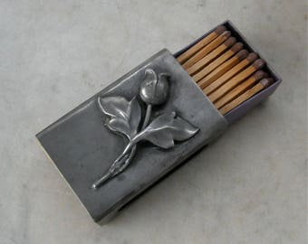 VINTAGE PEWTER MATCHBOX Raised Flower + Two Leaves + Stem on Pewter Base Striking Windows Both Sides American Match Box Holder 1910-1940's