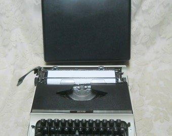 Vintage Sears, Roebuck, and Co. Black Manual/Portable Typewriter w/Carrying Case--Made in Japan--Works Good--Looks Good--Could Use NewRibbon