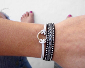 leather infinity bracelet with braid in black, silver, and white with lobster clasp chain closure. infinity circle charm.
