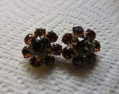 Vintage 1950s to 1960s Gold Tone Pronged Rhinestone Clip on Earrings Non Pierced Round Small Brown With Gray Centers Sparkly