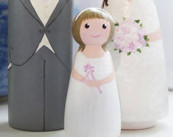 Custom hand painted bride and groom with flower girl or page boy peg doll wooden wedding cake topper