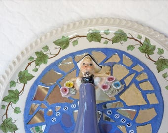 Mosaic assemblage, Dutch girl and teapot with flowers, Good morning wall hanging plate