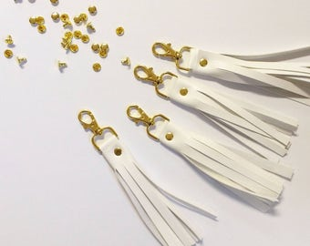 White and gold tassel