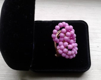 Ladies rose colored wire wrap cluster ring. Size 9